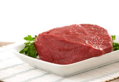 Fresh raw meat. On white plate Stock Photography