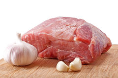 Fresh raw meat. And garlic isolated on white Stock Images