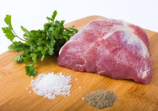 Fresh Raw Meat. With parsley,  salt and pepper Royalty Free Stock Photos