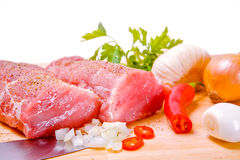 Fresh raw meat. Raw meat with chilli, garlic and herb Stock Photography
