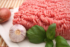 Fresh raw meat. With garlic and basil Royalty Free Stock Image