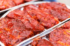 Fresh raw meat for babecue. Macro view of fresh raw pork marinated meat with spices and seasonings for barbecue Stock Photo