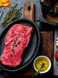 Fresh raw meat beef steak. Beef tenderloin, spices, herbs and vintage cutlery. Food background with copy space Royalty Free Stock Images