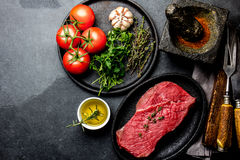 Fresh raw meat beef steak. Beef tenderloin, spices, herbs and vintage cutlery. Food background with copy space Stock Photography
