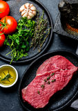 Fresh raw meat beef steak. Beef tenderloin, spices, herbs and vintage cutlery. Food background with copy space Royalty Free Stock Photo
