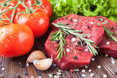 Fresh raw meat beef steak. Fresh raw beef steak with spice and vegetable on brown wooden table Stock Photography