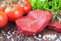 Fresh raw meat beef steak. Fresh raw beef steak with spice and vegetable on brown wooden table Stock Photos