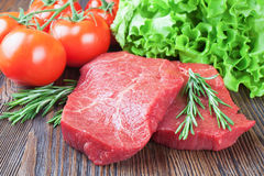 Fresh raw meat beef steak. Fresh raw beef steak with spice and vegetable on brown wooden table Royalty Free Stock Image