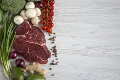 Fresh raw meat beef steak with spices, cherry tomatoes, health f. Fresh raw meat beef steak with spices, cherry tomatoes, health, flat lay Stock Photography