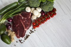 Fresh raw meat beef steak with spices, cherry tomatoes, health f royalty free stock photos