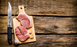 Fresh raw meat on a Board with a knife. Royalty Free Stock Photography