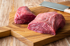 Fresh raw meat on chopping board. two peece of beef Stock Images