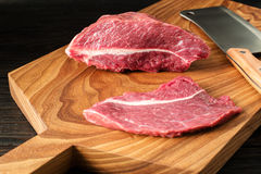 Fresh raw meat on chopping board. two peece of beef Royalty Free Stock Photo