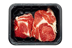 Fresh raw meat in container Stock Photography