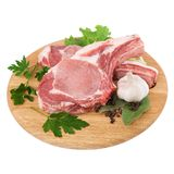 Fresh raw meat on cutting board. Fresh raw meat pork on cutting board in closeup over white background Royalty Free Stock Images