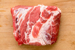 Fresh raw meat on a cutting board. A fresh chunk of raw meat on a cutting board Royalty Free Stock Photography