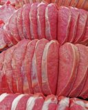 Fresh raw meat fillets at the market. Fresh raw meat fillets cut for sale at the market, food background Royalty Free Stock Image