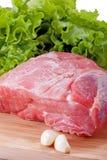 Fresh raw meat and garlic. Pork. Fresh raw meat and garlic Stock Photo