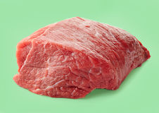Fresh raw meat. On a green background Stock Photos