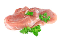 Fresh raw meat with greens. Parsley on white background Royalty Free Stock Photos