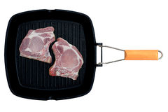 Fresh raw meat in a grill pan isolated. On white background Royalty Free Stock Photography