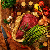 Fresh raw meat with herbs, spices and vegetables Stock Photo