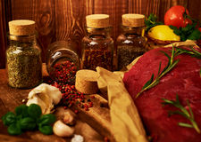 Fresh raw meat with herbs, spices and vegetables.  Royalty Free Stock Photo