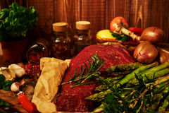 Fresh raw meat with herbs, spices and vegetables Royalty Free Stock Images