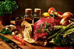 Fresh raw meat with herbs, spices and vegetables Royalty Free Stock Photo