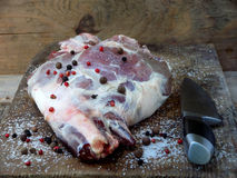 Fresh and raw meat. Leg of lamb with knife for roasting, stewing, pilaf, barbecue, kebab, shurpa Stock Photography
