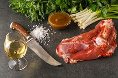 Fresh and raw meat. Leg of lamb on stone background Royalty Free Stock Photography