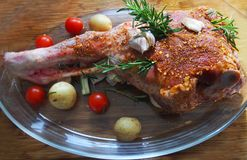 Fresh and raw meat. Leg of lamb on wood background. Spain stock images