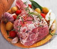 Fresh and raw meat. Leg of lamb on wood background. Spain royalty free stock photo
