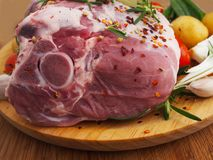 Fresh and raw meat. Leg of lamb on wood background. Spain royalty free stock photos