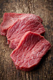 Fresh raw meat. On old wooden table Royalty Free Stock Images