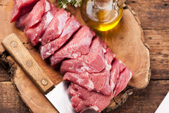 Fresh raw meat. On old wooden table Royalty Free Stock Photography