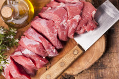 Fresh raw meat. On old wooden table Stock Photos