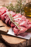 Fresh raw meat. On old wooden table Royalty Free Stock Image