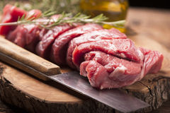 Fresh raw meat. On old wooden table Stock Images