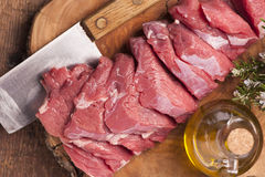 Fresh raw meat. On old wooden table Royalty Free Stock Photo