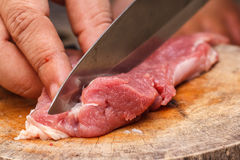 Fresh raw meat on old wooden table. Fresh raw meat on wooden table ready to cook Royalty Free Stock Photos