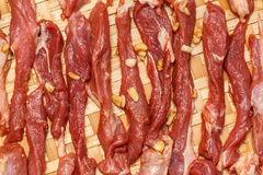 Fresh raw meat on old wooden table. Pork and knife with cutting on old wooden table Stock Photo
