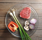 Fresh and raw meat an onion and mushroom Stock Image