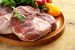 Fresh raw meat ossobuco. On a wooden board Stock Photo
