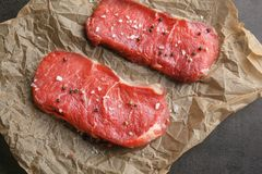 Fresh raw meat. On parchment paper Royalty Free Stock Image