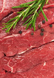 Fresh Raw Meat with pepper and rosemary. Close-up Stock Photo