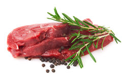 Fresh Raw Meat with pepper and rosemary. Isolated on white background Royalty Free Stock Photo