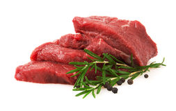 Fresh Raw Meat with pepper and rosemary. Isolated on white background Royalty Free Stock Images