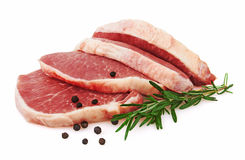 Fresh Raw Meat with pepper and rosemary Stock Photos