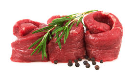Fresh Raw Meat with pepper and rosemary. Isolated on white background Stock Photo